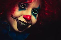 Creepy clown close up halloween portrait on black background. Creepy clown close up spooky halloween portrait on black background royalty free stock image