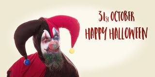 Creepy clown looking at text Happy Halloween, vintage look Royalty Free Stock Image