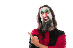 Creepy clown pointing with his finger to copyspace, isolated on Stock Photo