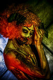 Creepy clown. Portrait of a terrible bloody redhead clown. Halloween. Horror royalty free stock images