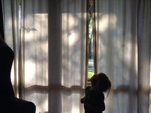 Creepy curtain. Child by Halloween decorations Royalty Free Stock Photography