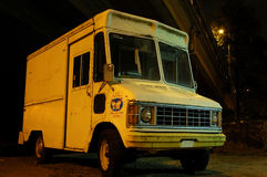 Creepy Dark Ice-Cream Truck. A creepy looking abandoned ice cream truck under a bridge at night stock photos