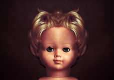 Creepy doll face royalty free stock photography