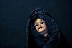 Creepy doll face Royalty Free Stock Photo
