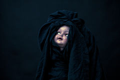 Creepy doll face stock images