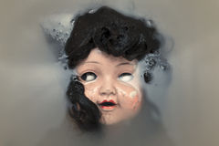 Creepy doll face Royalty Free Stock Photo