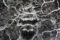 A creepy face looks from a wall Royalty Free Stock Image