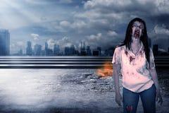 Creepy female zombie. Walking on destroyed city background Stock Images