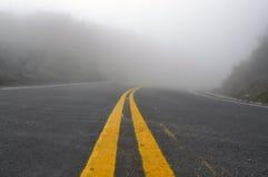 Creepy Foggy Road Royalty Free Stock Photos