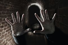 Creepy ghost hands in the dark scary underground stock photography