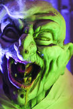 Creepy Green Goblin. Halloween Goblin close up in green colored lighting stock images