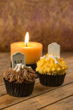 Creepy Halloween cupcakes and candle close-up Stock Images