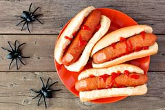 Halloween hot dog fingers over rustic wood Stock Photos