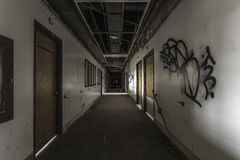 Creepy hallway in an abandoned hospital. With graffitti stock images