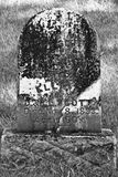 Creepy Headstone. Creepy Black and White Headstone with 19th Century Death Date royalty free stock image