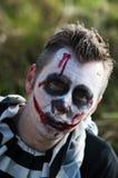 Creepy horror clown. A creepy horror cosplay photoshoot royalty free stock photography