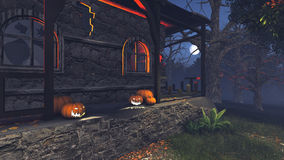 Creepy house with pumpkins at moonlight night. Carved Halloween pumpkins on the porch of the gloomy house at at moonlight night Stock Photography