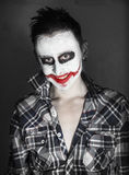 Creepy joker laughing Stock Photography