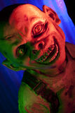 Creepy Little Goblin. Halloween Goblin close up in red and green colored lighting stock photos