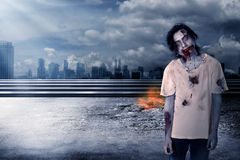 Creepy male zombie in the city Royalty Free Stock Photos