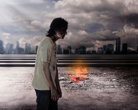 Creepy male zombie in the city. That on fire Stock Image