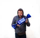 Creepy man with candy. Creepy young man with hood holding candy. Subject isolated on white background Royalty Free Stock Photography