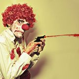 Creepy Manic Clown Shooting Blood From Cap Gun Stock Photos