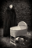 Creepy Masked and Cloaked Figure Royalty Free Stock Photography