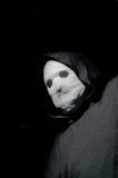 Creepy masked man Stock Images