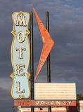 Creepy Motel. Motel sign set against a stormy sky Royalty Free Stock Photos