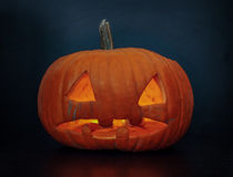 Creepy natural lighting pumpkin, jack o lantern royalty free stock photography