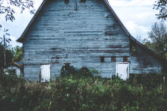 Creepy old barn in the Oregon countryside. Spooky old barn building in rural farmland setting Royalty Free Stock Photo