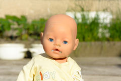 Creepy old doll with blue eyes Stock Image