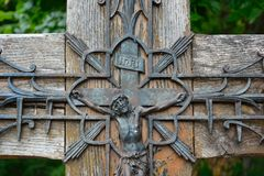 Creepy old iron statue. Creepy iron statue of Jesus on the cross and a lotus shape in Vic sur sere France Stock Images