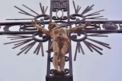 Creepy old iron statue. Creepy iron statue of Jesus on the cross  in Vic sur sere France Stock Photos