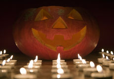Creepy pumpkin near candle, halloween concept Stock Photography