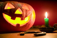 Creepy pumpkin near candle, halloween concept Stock Photo