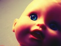 Creepy Retro Doll. Close-cropped image of a child's doll toy with vintage effect Royalty Free Stock Photos