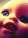 Creepy Retro Doll. Close-cropped image of a child's doll toy with vintage effect Royalty Free Stock Image