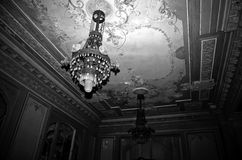 Creepy room. Chandelier hanging in a dark grungy room Stock Photos