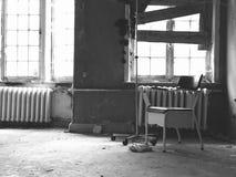 Creepy room. Creepy photo of a chair in a deserted mental hospital Stock Photos