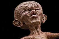 Creepy sculpture has pursed lips Stock Photos