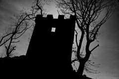 Creepy silhouette. Dark and Creepy silhouette of a castle look out post Stock Images