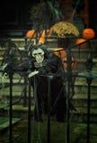 Creepy skeleton dreesed in black decoration on halloween Stock Photography