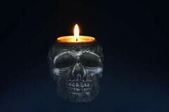 Creepy skull candle on black background - front Royalty Free Stock Photography