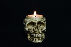 Creepy skull candle on black background - front Royalty Free Stock Photo
