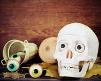 Creepy skull, halloween sweets and pumpkins Royalty Free Stock Images