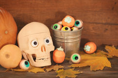 Creepy skull, sweets and pumpkins for Halloween party Stock Photo