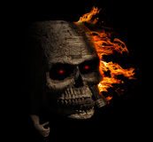 Creepy Skull wood facing left with fire Royalty Free Stock Image