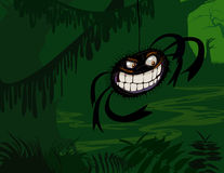 Creepy Spider in Dark Green Swamp. Evil spider with teeth hanging in a dark green tropical swamp or forest Royalty Free Stock Photo